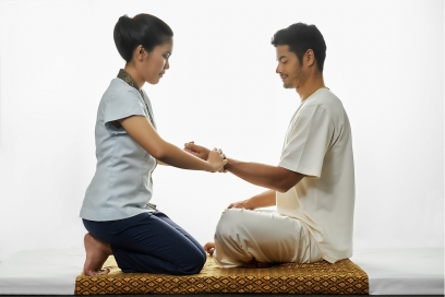 Traditional Thai acupressure practice for therapeutic treatment at Chiva Som Hua Hin