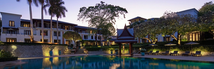 Outdoor pool flanked by Ocean Side guest rooms at Chiva-Som Hua Hin
